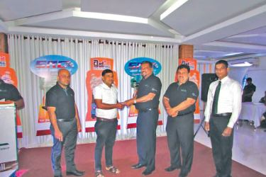 The cheque being received by the owner W S S Prasanna in the presence of Fazal Ghaffoor  CEO, ATL. Anaka Wijeyakumara Regional Manager for South and Sabaragamuwa Provinces, Tharanga Suren Branch Manager, Hambanthota and W.M.R.M Bandara Assistant Sales Manager, look on.