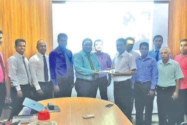 Representatives from PBSS and Freelan in Matara exchanging the agreement.