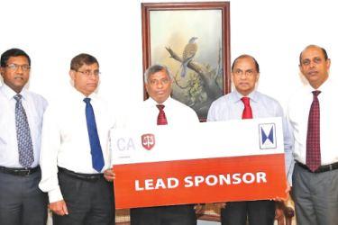 John Keells Holdings Group Finance Director Ronnie Peiris and Group Financial Controller  Mano Rajakariar handing over the lead sponsorship cheque to CA Sri Lanka President Lasantha Wickremasinghe, Vice President Jagath Perera and Chief Financial Officer Aruna Alwis.