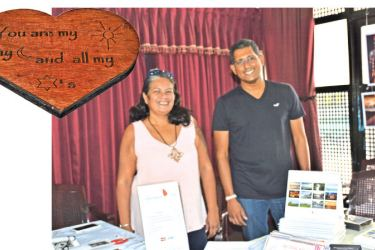 (Left) Customised wooden plaques and Mihiri and Viswanath at Taprobane Art