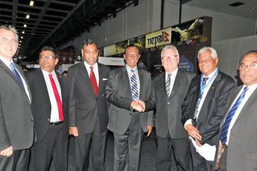 Tourism Minister John Amaratunge, Ambassador for Sri Lanka in Germany Karunatilleke Amunugama and MP's from the German Parliment and Sri Lanka Tourism officials at the opening ceremony. Pictures by Shirajiv Sirimane