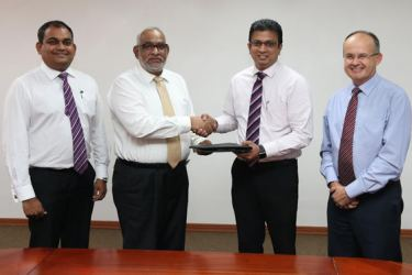 Commercial Bank's Deputy General Manager, Marketing Hasrath Munasinghe and the Bank's Managing Director/CEO Jegan Durairatnam with DialogAxiata's Group Chief Executive, Supun Weerasinghe and Jeremy Huxtable, Group Chief Officer, Dialog Axiata.