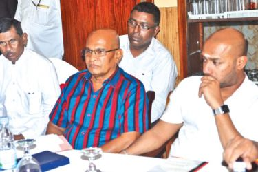 Northern Province Governor Reginald Cooray and SLFP General Secretary and Agriculture Minister Duminda Dissanayake presiding the meeting of Jaffna Local Government Election candidates