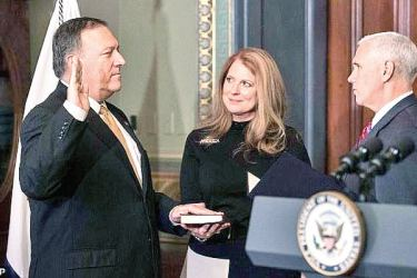 US Vice President Mike Pence (R) swears in Mike Pompeo as CIA director as his wife Susan looks on in the Vice President's Ceremonial Office at the Eisonhower Executive Office Building on January 23, 2017 in Washington, DC.