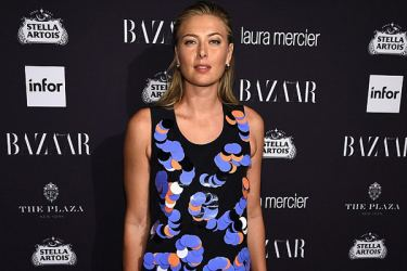 The Russian is on the red carpet, wearing a Victoria Beckham dress for the Bazaar Icons event
