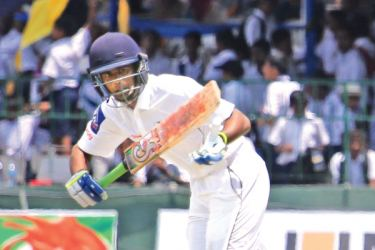 Thomian Ravindu Kodituwakku who made 98 sets off for a run on the second day of the 138th Battle of the Blues against Royal at the SSC grounds yesterday.  Pics by Thilak Perera