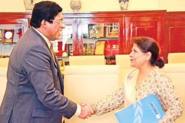 Finance Minister Ravi Karunanayake receiving the Executive Secretary of the United Nation's Economic and Social Commission for Asia and the Pacific, Shamshad Akhtar