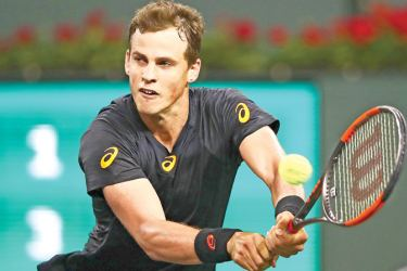 INDIAN WELLS, CA - MARCH 11: Vasek Pospisil of Canada plays a backhand during his straight sets victory against Andy Murray of Great Britain in their second round match during day six of the BNP Paribas Open at Indian Wells Tennis Garden on March 11, 2017