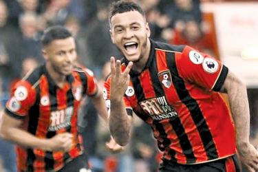 Bournemouth's Joshua King celebrates scoring their third goal to complete his hat trick in their Premier League match against West Ham United at Vitality Stadium on Saturday.