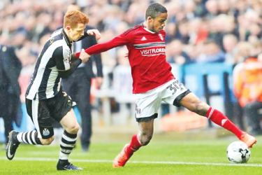 Ryan Sessegnon of Fulham in action with Jack Colback of Newcastle United.