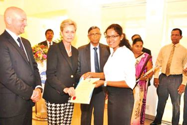 The President of IFAC  Olivia Kirtley (2014 - 2016) presents the Final Certificate to S. Thushinthyaa passed finalist of CMA in the presence of Russel Guthrie Executive Director IFAC and President of CMA Prof. Lakshman R Watawala