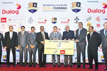 Daminda Gamlath, Vice President – John Keells Holdings, and Head of Beverages – Elephant House, (3rd from right) handing over the sponsorship cheque to B.A. Abeyratne, Principal, Royal College and Revd Fr. Marc Billimoria - Warden, S. Thomas' College, Mt. Lavinia.
