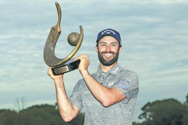 Adam Hadwin of Canada holds the trophy after winning the Valspar Championship during the final round at Innisbrook Resort Course on March 12,
