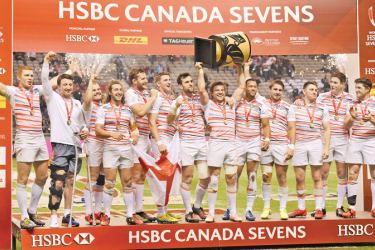 England celebrates their 19-7 victory over South Africa in the final of the HSBC Canada Sevens Series Rugby Tournament at BC Place Stadium in Vancouver,  March 12.  AFP