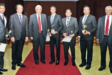 Dr. Indrajit Coomaraswamy, Governor Central Bank and other officials of the Bank of Ceylon with the IBSL winners.