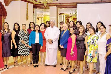 Ports and Shipping Minister Arjuna Ranathunga with the first batch of women crane operators.