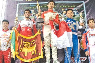 Eshan Peiris holding the Lion flag with other winners on the podium