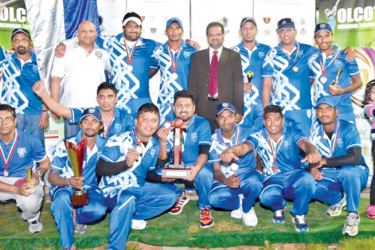 The champion Dharmasoka College Past Pupils cricketers with their trophies