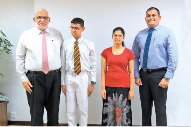 The two students with the Bank's Managing Director Jegan Durairatnam and Deputy General Manager Marketing, Hasrath Munasinghe.