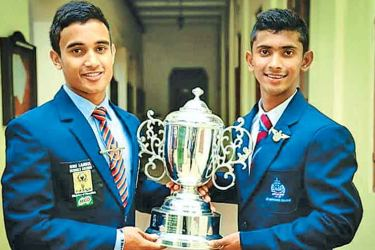 The Trinity College and St Anthony's College captains with the John Halangoda memorial trophy