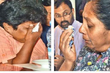 Some of the distraught relatives of the crew being held on the Aris 13. Pictures by Wimal Karunathilake