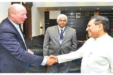 Health Minister Dr. Rajitha Senaratne and New Zealand Food Safety Minister David Bennett shake hands after the meeting.