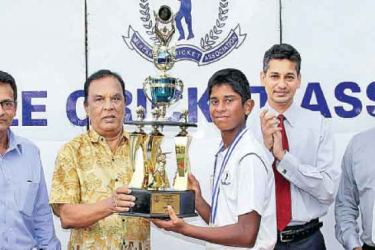 Winning Captain of MCA Cricket Academy Adithya Hettiarachchi receiving the MCA Trophy from the Chief Guest, former NCC President and the current Chairman of the Cricket Committee, Leslie Hewage (2 nd from left). Others in the picture from Left : Dilip Somaratne (Head Coach NCC Cricket Academy), Niran Mahawatte (President MCA), Mahesh de Alwis (Chairman - Cricket Development Committee - MCA).