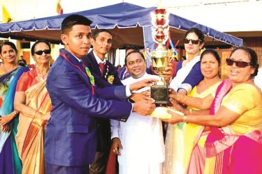 Standing  from  left Shehan Jayawardena House Captain of the winning House, Guest of Honour Dilip Ruwan, Chief Guest Hon Isuru Devapriya, Vice Principal Mrs. Kartini Rawdin, Vice Principal Ms Ranmali Perera,and Principal of  Highlands College Mrs. Malini Abeysekera Dissanayake