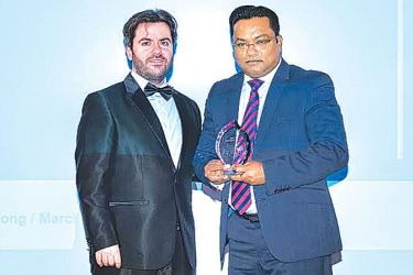 Mobitel Administration Head Wajira Perera receiving the award from LeFonti Group President Guido Giommi at the IAIR Awards 2017 in Hong Kong.