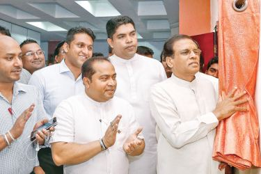 President Maithripala Sirisena unveils the plaque of the political academy of the Sri Lanka Freedom Party's Youth Front at the SLFP Headquarters yesterday. Ministers Mahinda Samarasinghe, Susil Premajayantha, Duminda Dissanayake, SLFP Youth Front Chairman Shantha Babdara and Secretary Eric Prasanna Weerawardena were present on the occasion.Picture courtesy President's Media Division