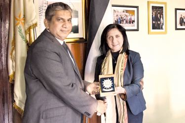 Vera Baboun presents a memento to Fawzan Anver