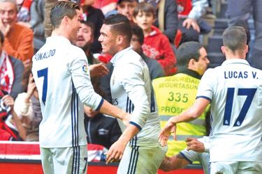 Real Madrid's Cristiano Ronaldo, Carlos Casemiro, Lucas Vazquez and Sergio Ramos celebrate goal by Carlos Casemiro in their Spanish Liga Santander match against Athletic Bilbao at San Mames, Bilbao, Spain on Saturday