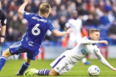 Newcastle United's Dwight Gayle is fouled by Birmingham City's Maikel Kieftenbeld in their Sky Bet Championship match at St Andrews on Saturday.