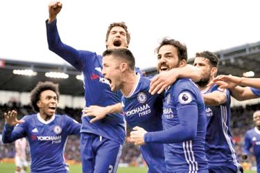 Chelsea's Gary Cahill celebrates scoring their second goal with teammates in their Premier league match against Stoke City at bet365 Stadium.