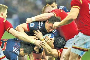 Wales' players react at the end of the match against France at Stade de France, Saint-Denis, Paris on Saturday.