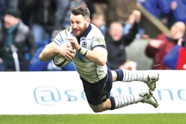 Scotland's Tommy Seymour (R) scores their fourth try in the Six Nations Championship match against Italy at BT Murrayfield Stadium, Edinburgh