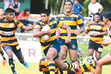 Royal hero number eight Hamza Reeza on his way to score one of his two tries against D.S.Senanayaka played at Navy grounds in Welisara. Picture by Saman Sri Wedage