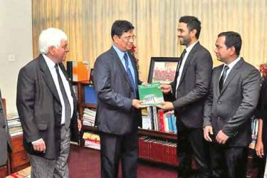 The Neethiya-26 (26th Anniversary volume) is being presented to Chief Justice Priyasath Dep