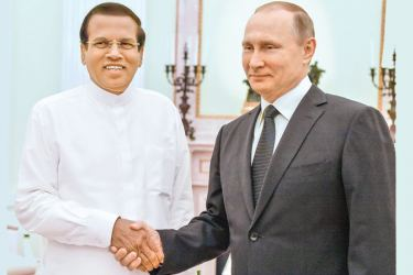 Russian President Vladimir Putin greets President Maithripala Sirisena during bilateral discussions at the Kremlin in Moscow recently.