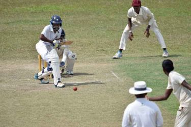 Lakindu Chamodya who scored a half century for Rahula in action on the first day of the 6th Ruhunu Maya cricket encounter against Dharmapala at De Soysa Stadium Moratuwa yesterday.