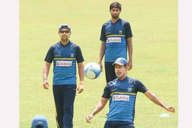 Sri Lanka cricketers during a practice session at the R Premadasa Stadium yesterday in preparation for today's third ODI against Bangladesh at the SSC. AFP