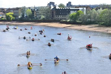 People row along the River Thames ahead of the Oxford University and Cambridge University boat races in London on April 2. AFP