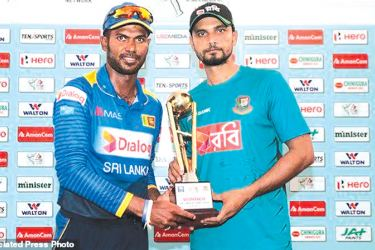 Sri Lanka captain Upul Tharanga and Bangladesh captain Mashrafe Mortaza pose with the trophy after the three-match ODI series ended in a one-all draw