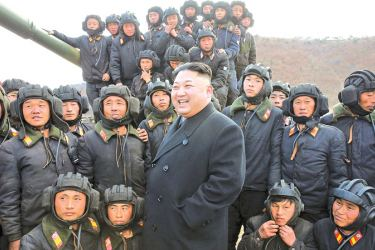 North Korean leader, Kim Jong-un, with tank crews, in an undated photograph.