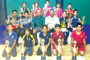 Age category winners and runner-ups with their trophies along with TTSL officials.