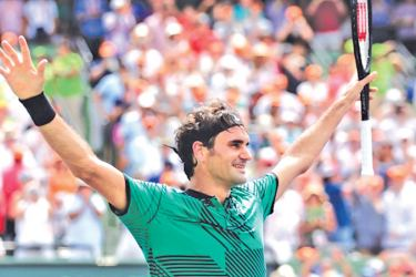 Roger Federer celebrates after defeating Rafael Nadal in the men's singles final at the Miami Open on Sunday in Key Biscayne.