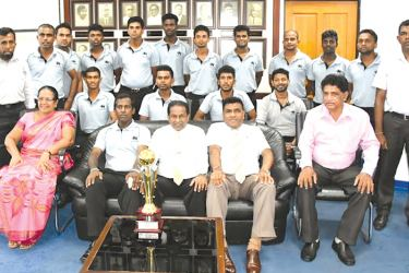 Deaf cricketers and SLDCA officials with SLC president Thilanga Sumathipala, SLC vice president, M. Mathivanan with the 2016 Deaf Cricketers' Asia Cup runner-up trophy at the SLC