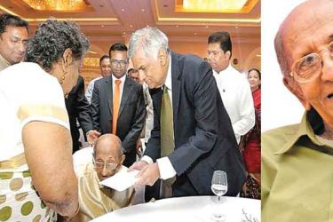 Prime Minister Ranil Wickremesinghe with Dr Peries