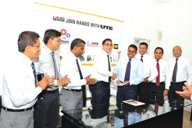 The MoU  being exchanged between Riyad Ismail, CEO – UTE and Dilshan Rodrigo, COO – HNB in the presence of UTE and HNB team