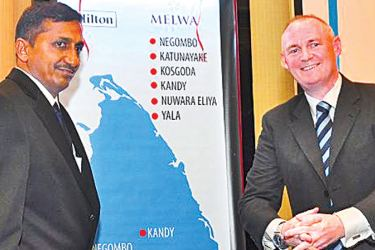 Melwa Hotels and Resorts Director T.P.Anandaraja unveiling the Hilton hotel chain map in Sri Lanka with Hilton's South East Asia and India Vice President William Costley yesterday. Picture by Thushara Fernando.